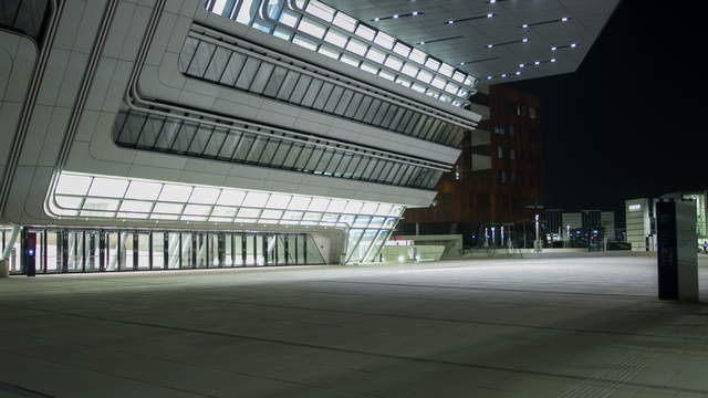 Main building at the new university of economics Vienna at night – Hyperlapse